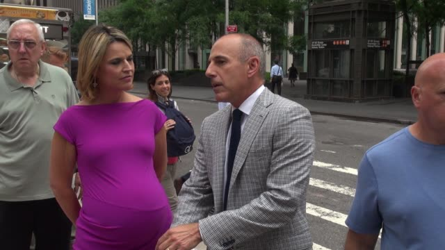 savannah guthrie and matt lauer talk about who they would like to interview while walking back to the today show in rockefeller center - celebrity... - savannah guthrie stock videos & royalty-free footage