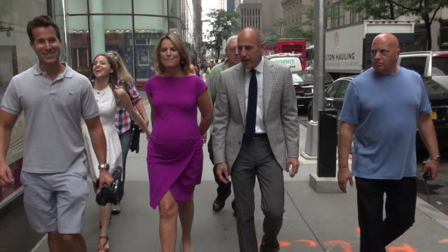 savannah guthrie and matt lauer talk to the tmz reporter as they walk back to the today show in rockefeller center - celebrity sightings in new york... - savannah guthrie stock videos & royalty-free footage