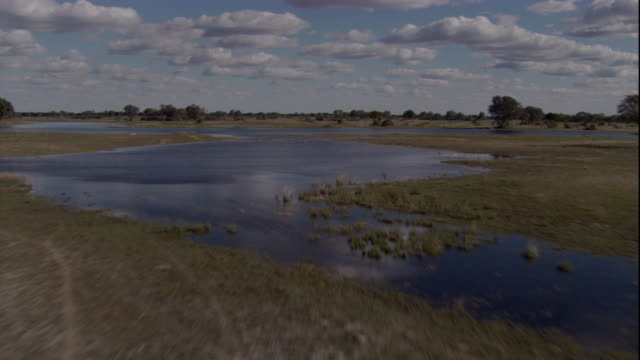 Savannas and floodwaters cover the Okavango Delta in Botswana from. Available in HD.