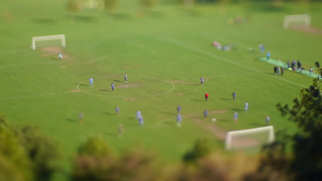 a save and a miss during a local soccer match - football pitch stock videos & royalty-free footage