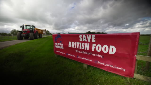 save british food sign on farm, as there are worries that new farming and animal standards laws post brexit will result in lowering of food standards... - tractor stock videos & royalty-free footage