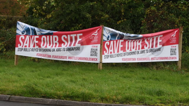 """save our site"" banners outside the rolls royce plant against moving the production to singapore in barnoldswick, lancashire, uk on tuesday, october... - automobile industry stock videos & royalty-free footage"