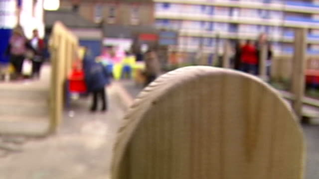 'save the children' charity criticises government benefits reforms ext blurred shot of children in playground pan sally copley interview sot for mums... - save the children stock videos & royalty-free footage
