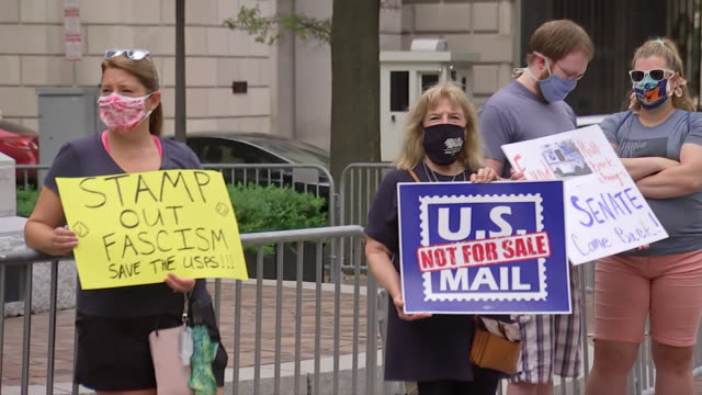 save the post office protest outside of the trump hotel in washington dc - united states and (politics or government) stock videos & royalty-free footage