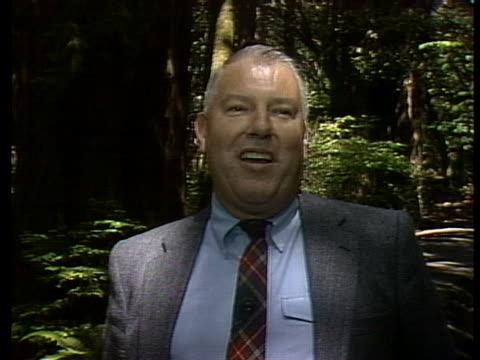 save the redwoods league spokesperson john dewitt discusses the history of redwoods in california - 木を抱く点の映像素材/bロール