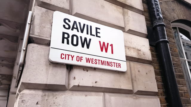 stockvideo's en b-roll-footage met savile row straatnaam teken in londen westminster - street name sign