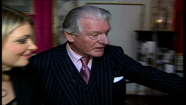 savile row tailors exhibition in florence 2shot angus cundey with sylvester interview sot talks about coats and items on display cutaways coachman... - savile row stock videos and b-roll footage