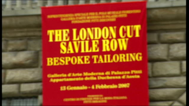 savile row tailors exhibition in florence close up of london saville row bespoke tailoring banner on side of building exhibition building - savile row stock videos and b-roll footage