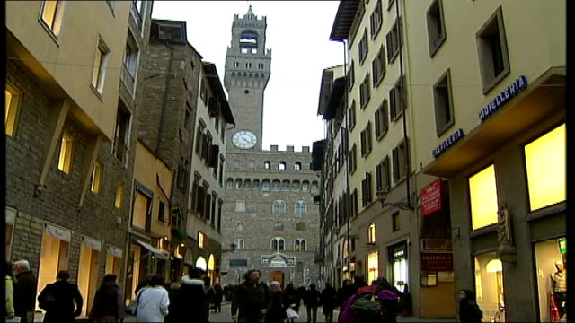 savile row tailors exhibition in florence italy florence ext ponte vecchio bridge florence town hall seen from street tilt down as people along... - savile row stock videos and b-roll footage