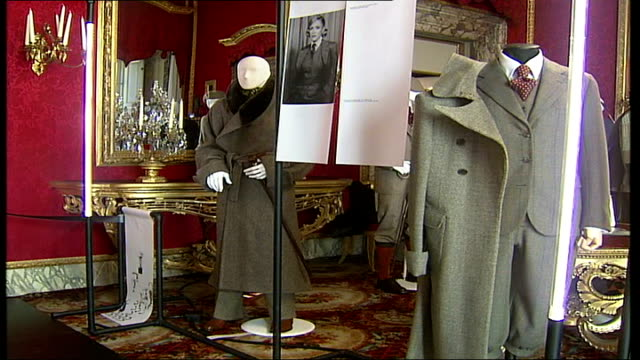 savile row tailors exhibition in florence; saville row tailored clothing in exhibition display chandelier tilt down to saville row exhibition display... - tailored clothing stock videos & royalty-free footage