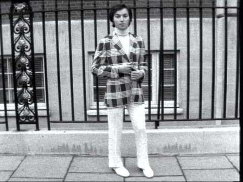 hardy amies spring collection england london ext models walking along street in various fashion clothes various shots man in suit and bowtie man in... - neckwear stock videos and b-roll footage