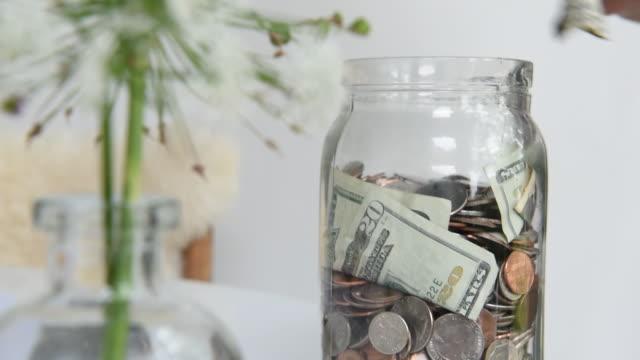 saving money in a jar - jar stock videos & royalty-free footage