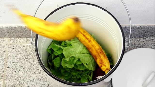 t/l slo mo saving still edible food (reverse motion) - banana stock videos & royalty-free footage