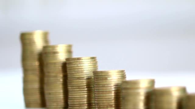 Savings, increasing columns of gold coins