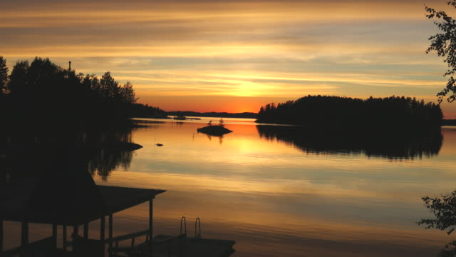 savonlinna, view of the lakes in sunset. - finlandia video stock e b–roll