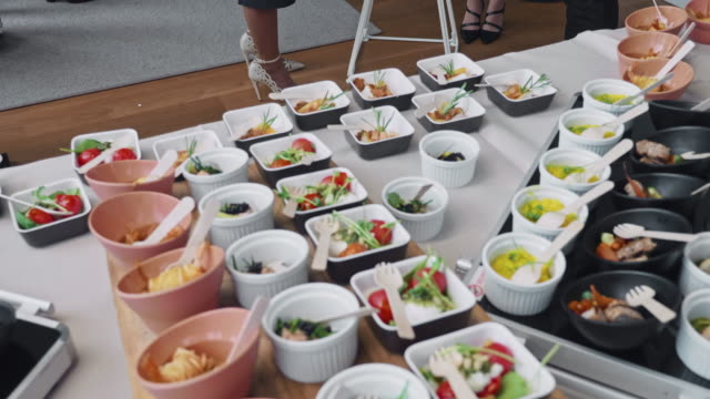 savory and sweet gourmet food at corporate office party - savory food stock videos & royalty-free footage