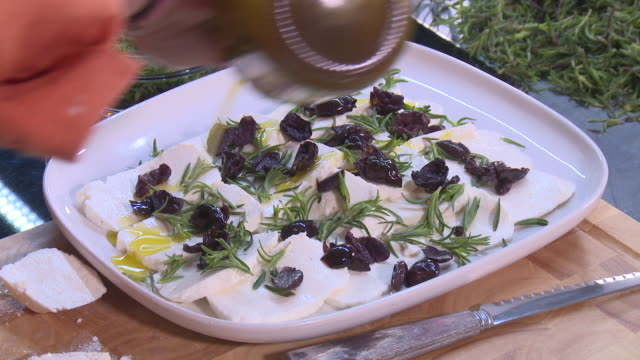savory, goats cheese and black olives salad - eastern european culture stock videos & royalty-free footage