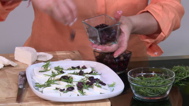 savory, goats cheese and black olives salad - シェーブルチーズ点の映像素材/bロール