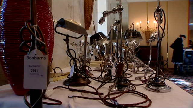 savoy hotel general views visitors looking at savoy hotel artefacts and objects laid out on tables for auction including lamps silver plate covers... - decanter stock videos & royalty-free footage