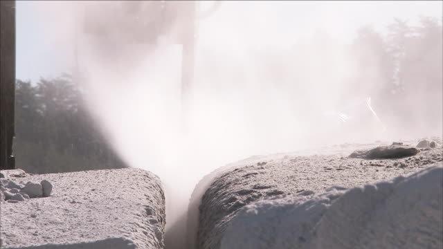 a saw cuts through blocks of granite at a quarry. - granite rock stock videos & royalty-free footage