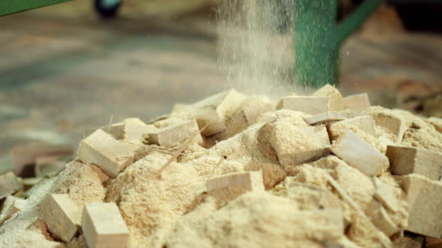 sawdust falling on the pile - timber stock videos & royalty-free footage