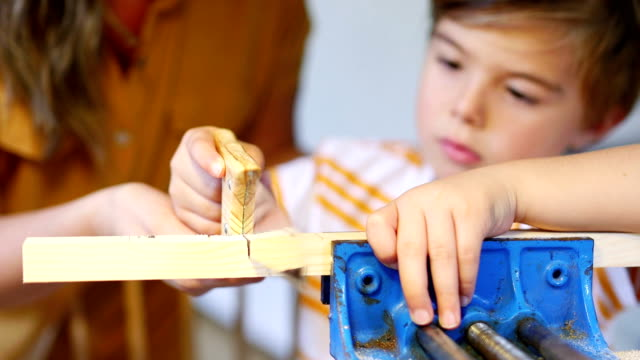 Sawing Wood with his Mother