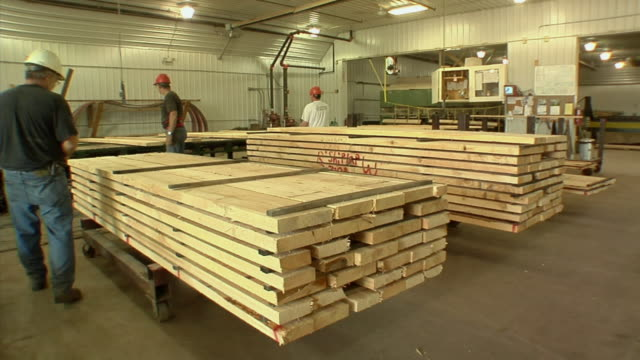 ms, sawmill workers stacking timber in factory, manistique, michigan, usa - plank stock videos & royalty-free footage
