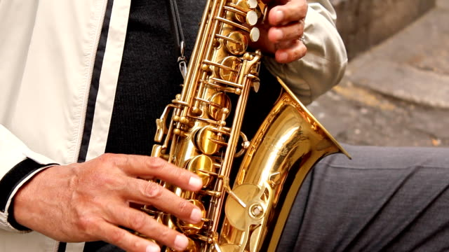 sax player (hd) - plucking an instrument stock videos and b-roll footage