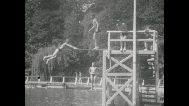 saxony, vogtland in the city netzschkau, open air pool of the city 1932, 4 boys between 10 and 16 years old having fun, best friends, jumping from... - dresden germany stock videos & royalty-free footage