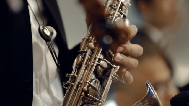saxophone player performs on stage - organisation stock videos & royalty-free footage