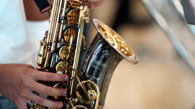 saxophonist. hands holding alto saxophone performance at concert. - alto saxophone stock videos and b-roll footage