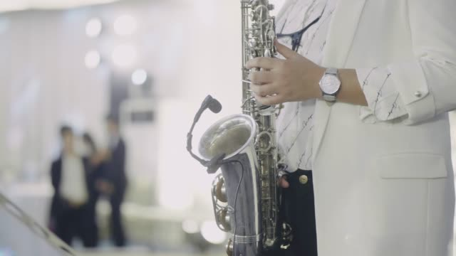 saxophonist perform on stage. - musical instrument stock videos & royalty-free footage