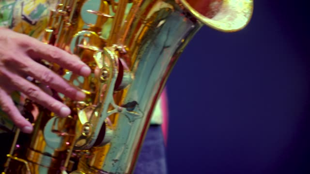 saxophonist perform on stage. - brass band stock videos & royalty-free footage