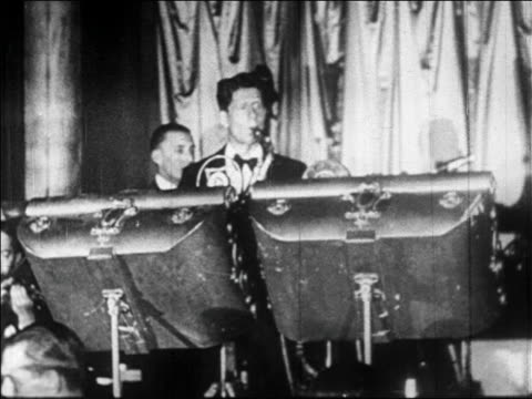 b/w 1928 saxophonist playing in band in villa vallee nightclub / nyc / newsreel - 1928 stock videos & royalty-free footage