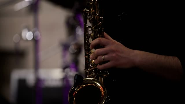 saxophonist playing saxophone - saxophone stock videos & royalty-free footage