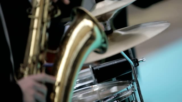 saxophonist playing saxophone with his band - saxophone stock videos & royalty-free footage