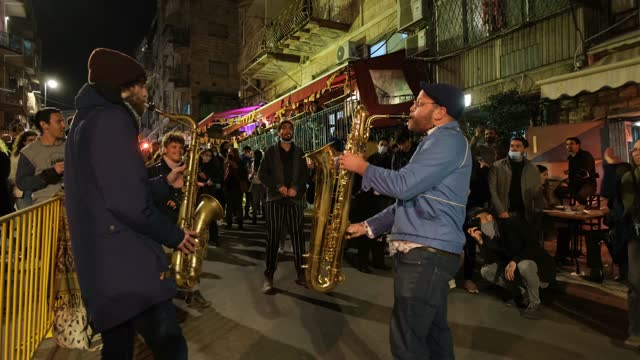 saxophonists entertain people outside bars during the annual shaon horef open culture festival on march 17 in downtown jerusalem, israel. following... - israel stock videos & royalty-free footage