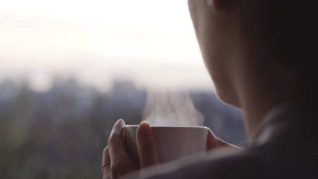 saying good morning with a warm cuppa - mug stock videos & royalty-free footage