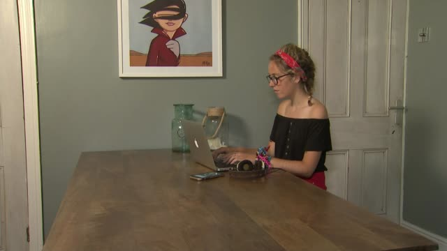 NSPCC says rise in selfharming amongst girls is heart breaking ENGLAND INT Lara Ferguson interview SOT Various of Lara Ferguson working at laptop...