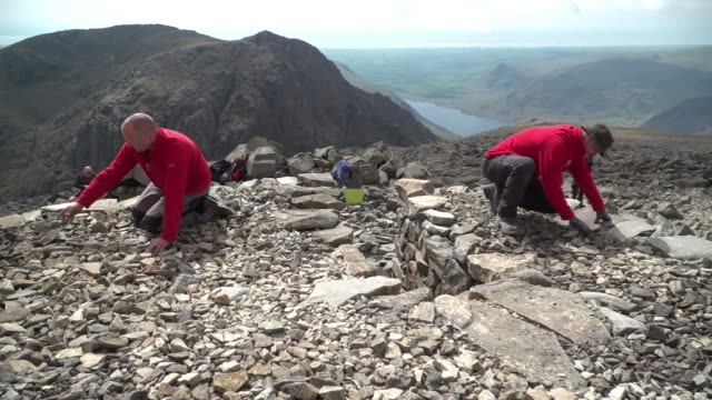 Scafell Pike war memorial restored ENGLAND Location unknown INT Dr Jane Bywater interview SOT Lake District Scafell Pike EXT Plaque on summit cairn...
