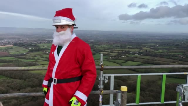 scaffolders get into the festive spirit and dress in santa outfits as they construct scaffold around the wellington monument on the blackdown hills... - obelisk stock videos & royalty-free footage