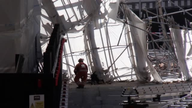 a scaffolding collapsed suddenly on a demolition site in reading shortly after 1115am on thursday the emergency staff could be seen with dogs... - scientific imaging technique stock videos and b-roll footage