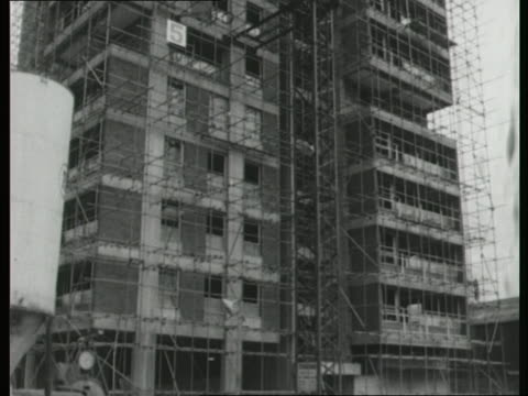 scaffolding covers a high rise tower block under construction in london - tower stock videos & royalty-free footage