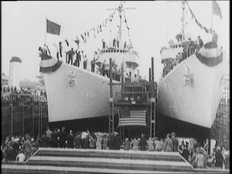scaffolding erected around battleship alabama / deck of ship under construction / worker riveting / cameraman ship captain on rising platform / bow... - juneau stock videos and b-roll footage