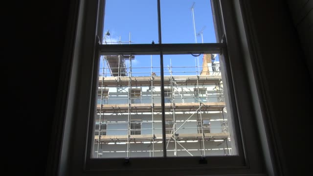 scaffolding in central london filmed through a sash window from flat on the other side of the street - sash window stock videos and b-roll footage