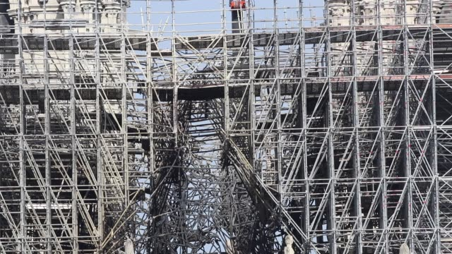 scaffolding partly burned on the roof of the cathedral / a fire broke out on monday afternoon and quickly spread across the building causing the... - spire stock videos and b-roll footage