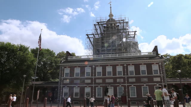 la scaffolding surrounding bell tower of independence hall, tourists and pedestrians walking by / philadelphia, pennsylvania, united states - independence hall stock videos and b-roll footage