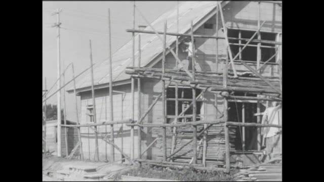 scaffolding surrounds new houses under construction in postwar japan. - postwar stock videos & royalty-free footage