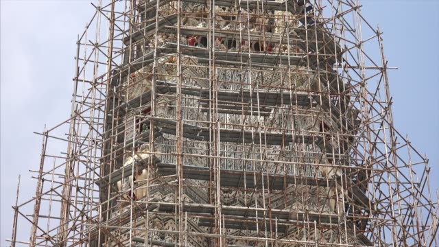 scaffolding surrounds wat arun tower during renovation in bangkok, thailand - scaffolding stock videos and b-roll footage