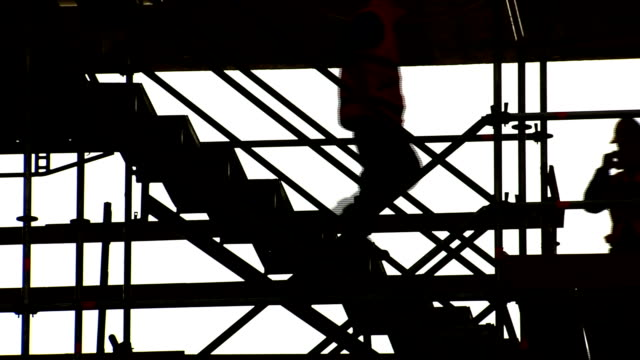 scaffolding with workers descending stairs - ladder stock videos and b-roll footage